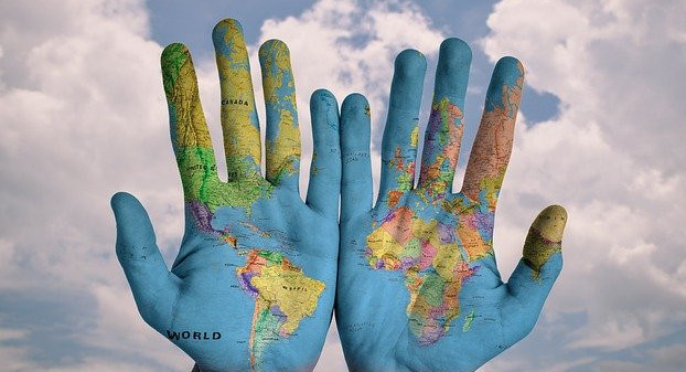 globe humans hand in hand