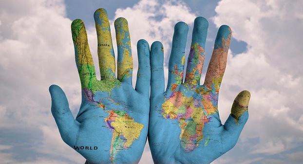 globe humans hand in hand
